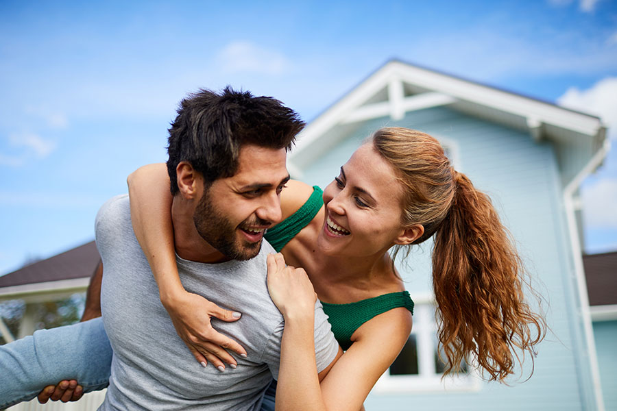 Contact - Happy Couple Celebrating the Purchase of Their First Home